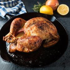 Roast chicken with lemon, white wine, rosemary and thyme sauce.