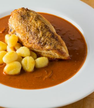 Chicken paprikash is traditionally braised. Try this recipe to keep the skin crisp while maintaining the depth of flavour of a braised dish