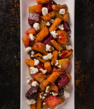 Roasted beets and carrots with goat cheese. This dish is brightened by a balsamic glaze to bring out the sweetness of the root vegetables.