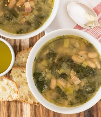 White bean swiss chard soup with leeks and bacon. A hearty, warming soup that chases away the winter blahs no matter how miserable it is out.