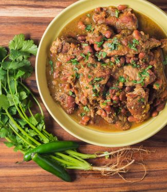 Braised pork with tomatillos and pinto bean chili