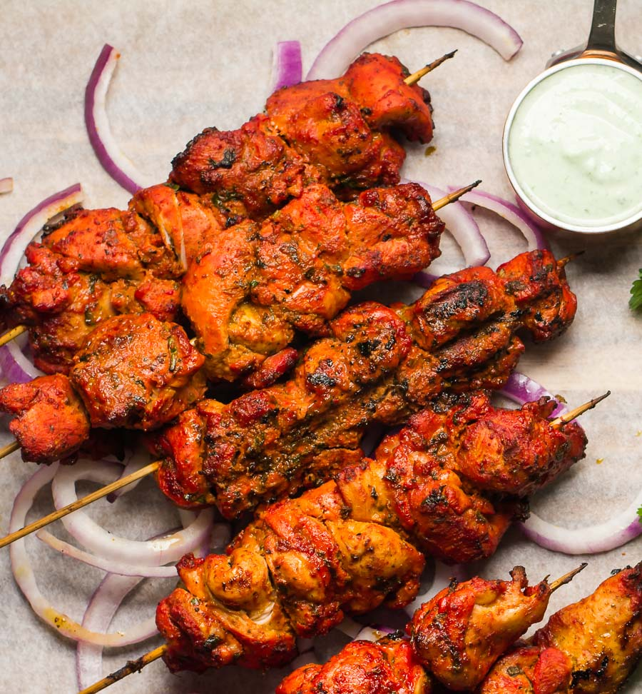 Tandoori marinade on chicken tikka skewers.