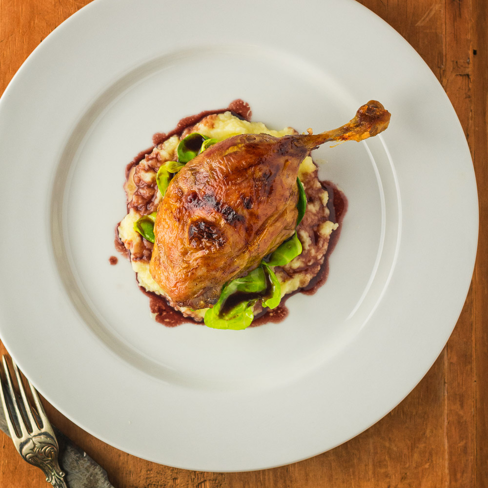 Roast duck with parsnip puree and port wine sauce.
