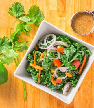 Lime, soy and tahini dress this healthy kale salad.