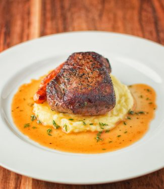Steak with thyme infused white wine sauce