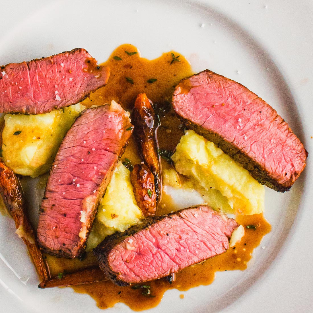 steak with thyme infused white wine sauce and truffled mashed