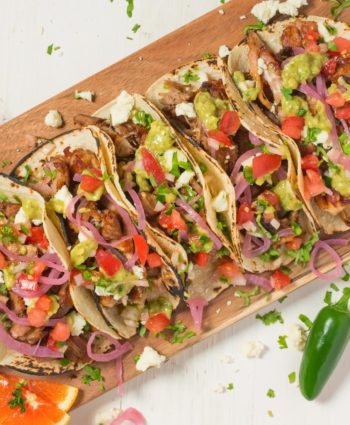 loaded carnitas tacos with avocado tomatillo salsa