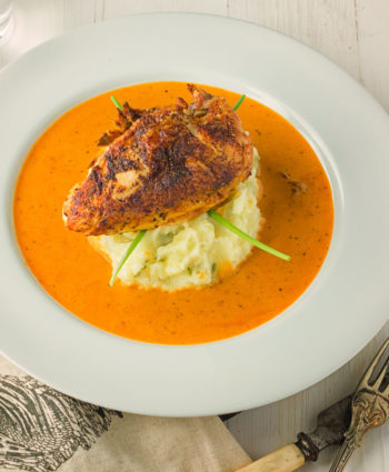 chicken with creole cream sauce and green chili mash