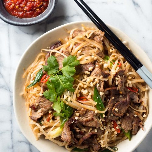 Thai beef noodles with chopsticks from above