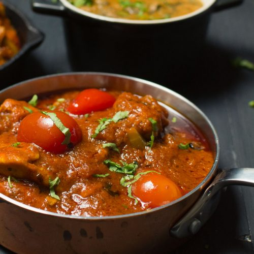 Bhuna curry close up in small copper pan
