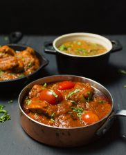 Indian restaurant bhuna curry is a thick curry loaded with tomato, spices and onions.
