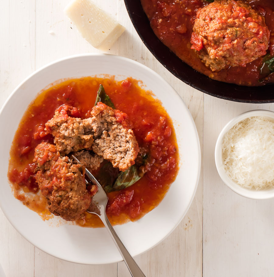 Rao's meatball with marinara on a small plate with fork.