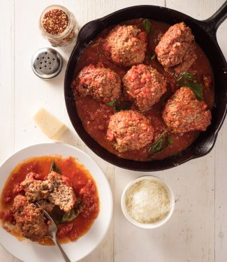 raos meatballs in marinara in a black cast iron frying pan