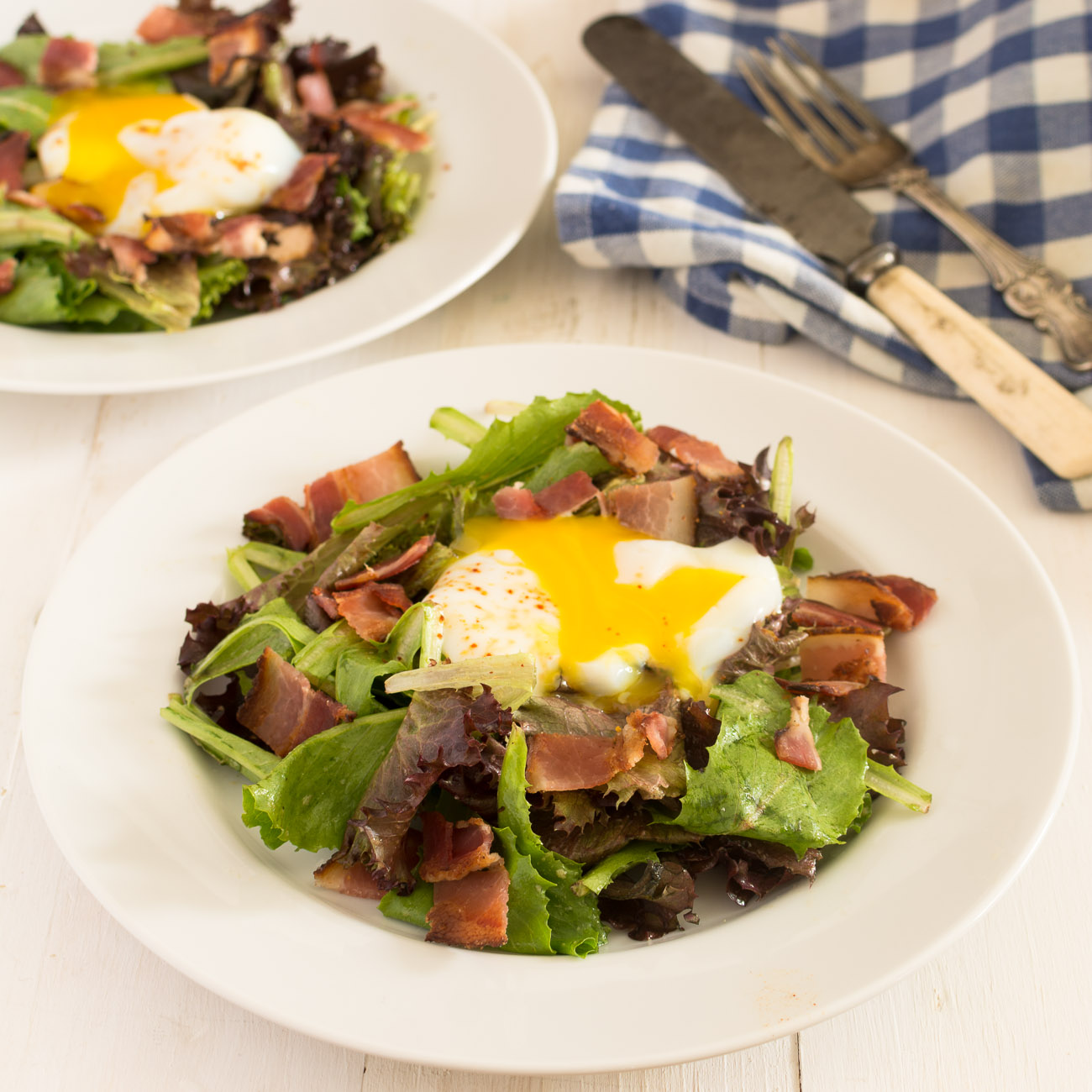 Salade lyonnaise is a classic French salad with poached egg and bacon.