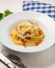 Spaghetti with sun-dried tomatoes and pecorino romano is a delicious weeknight meal.