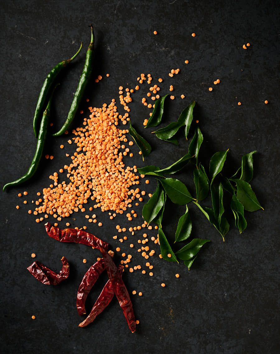 Masoor dal, kashmiri chilies, fresh curry leaves and green chilies from above.