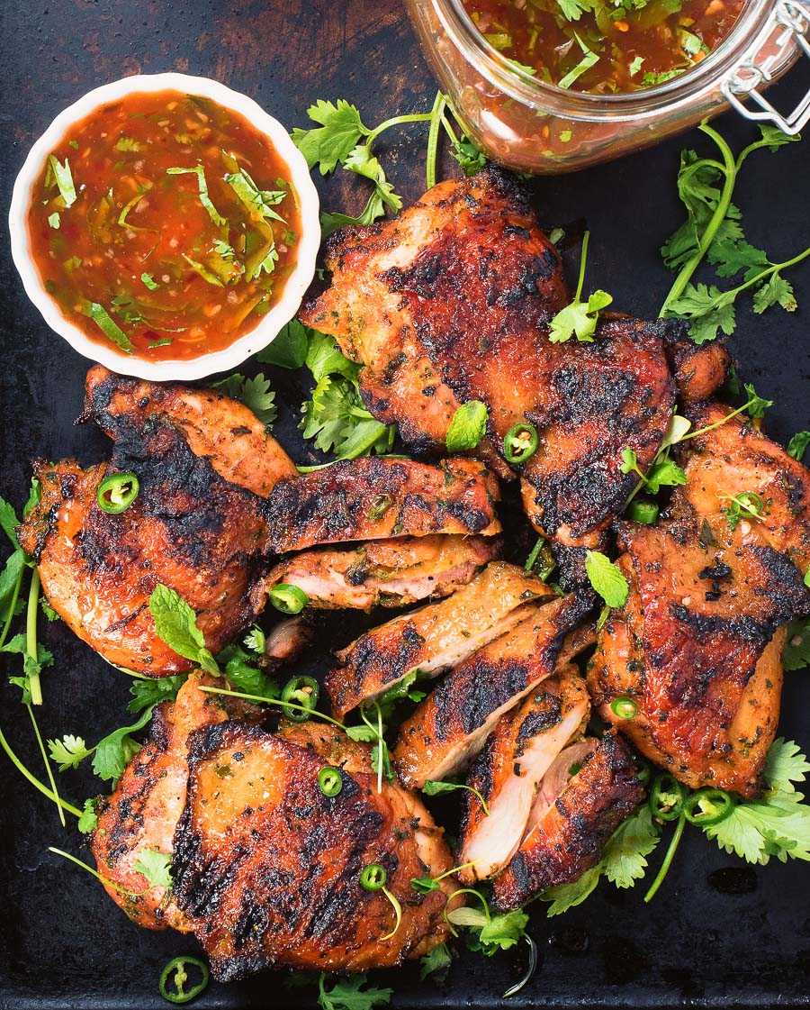 Thai grilled chicken with sweet chili sauce is a delicious way to mix up your summer grilling.