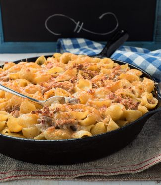 Baked pasta with sausage alfredo sauce is an easy way to get your pasta al forno fix.