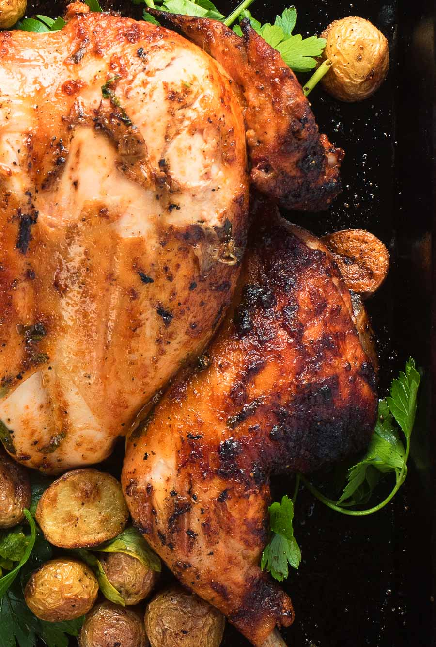 Portuguese chicken and potatoes from above - breast and thigh