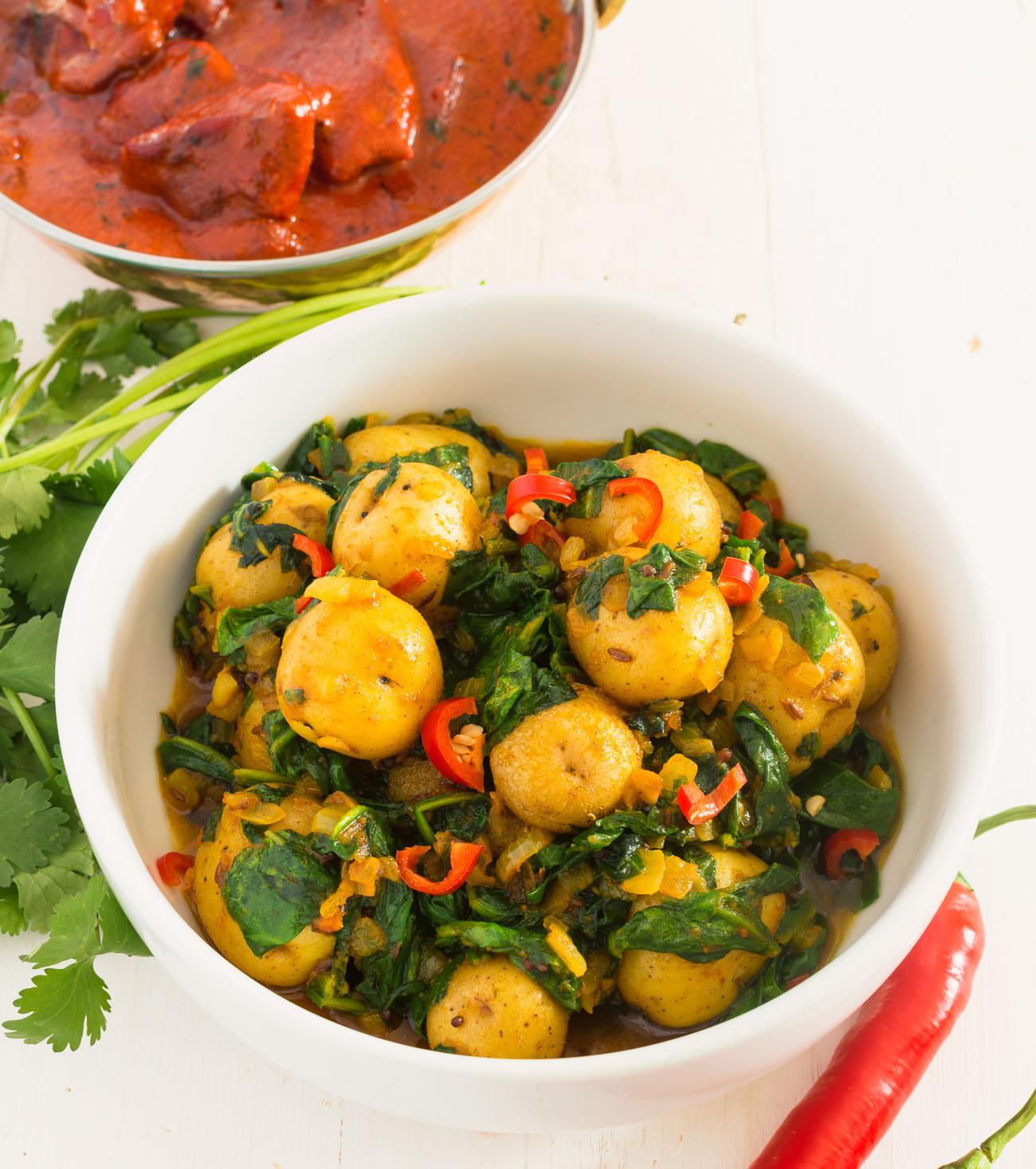 Sag aloo or spinach and potato curry is a delicious vegetarian meal.