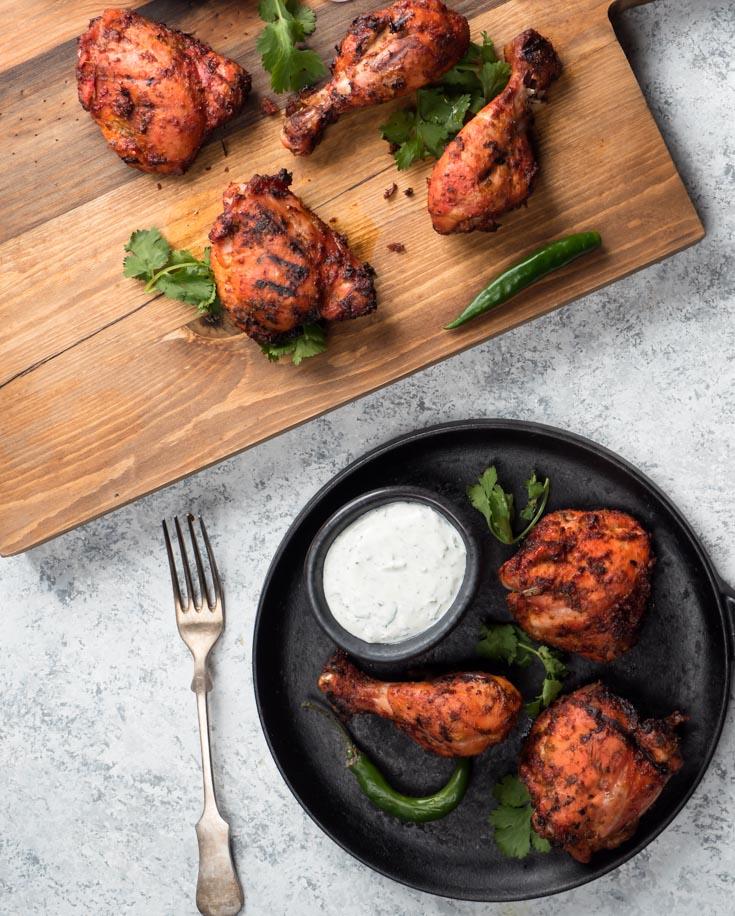 tandoori chicken on cast iron with mint raita