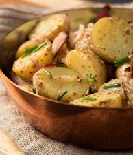 Warm potato salad with bacon makes a great side any time you grill.