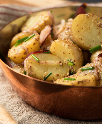 Warm potato salad with bacon and coarse mustard