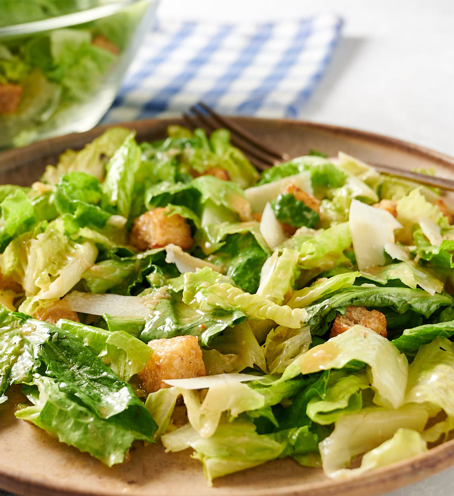 Close up of Caesar salad on a plate from the front.