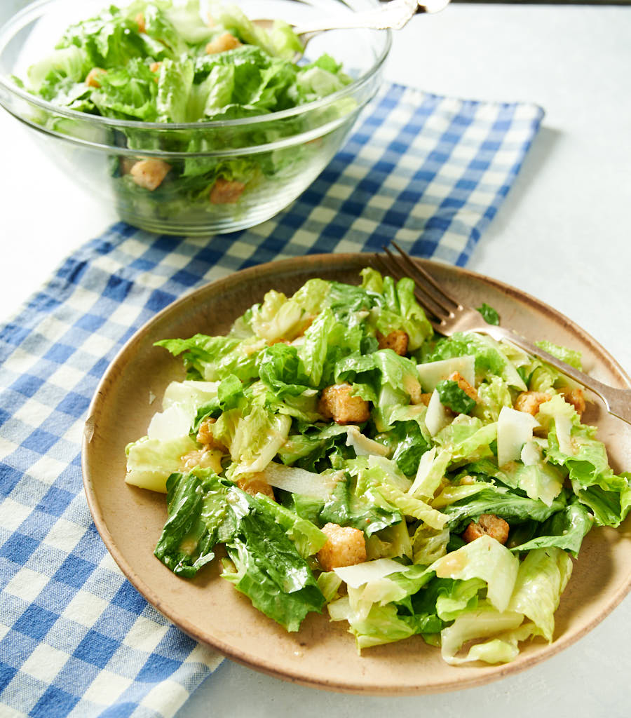 Plate of Caesar salad with fork.