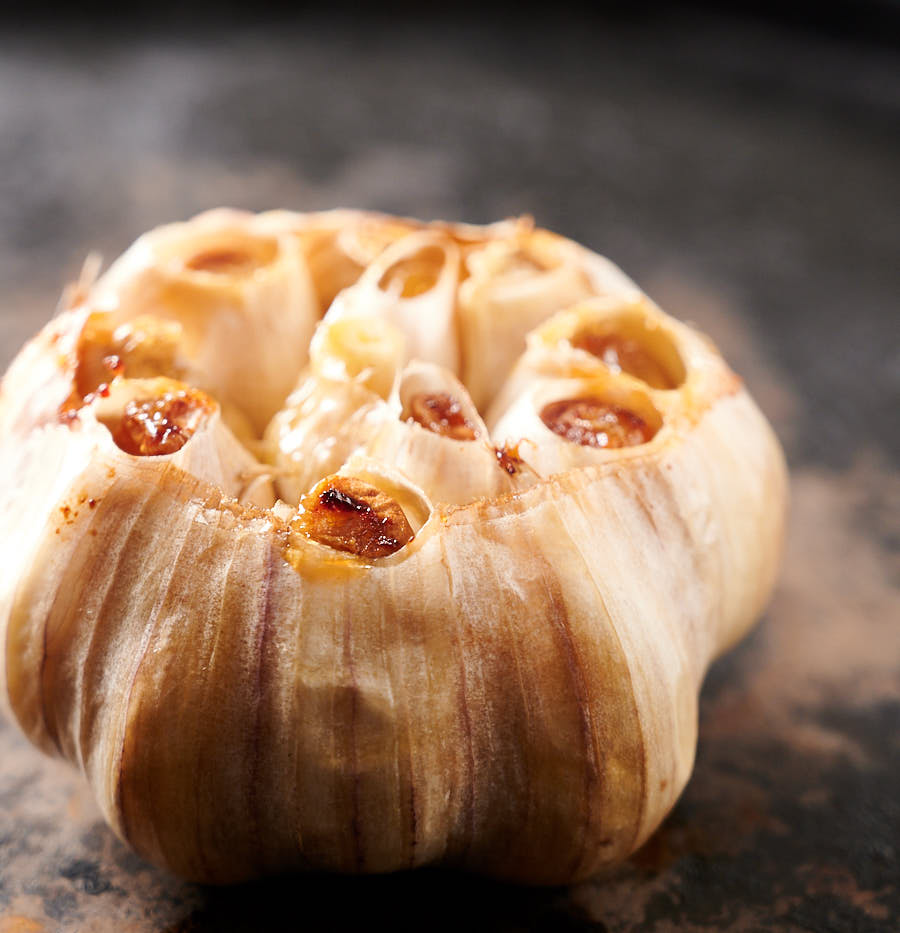 A head of roasted garlic from the front.