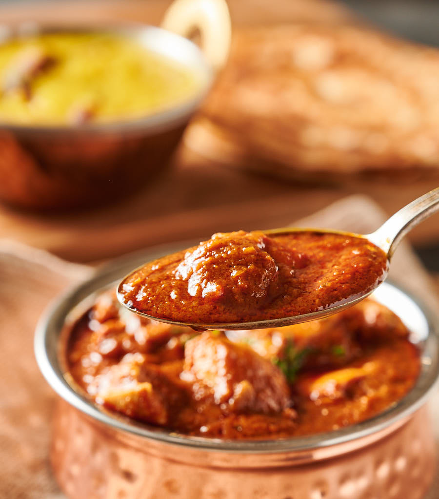 Spoonful of restaurant style pathia curry.