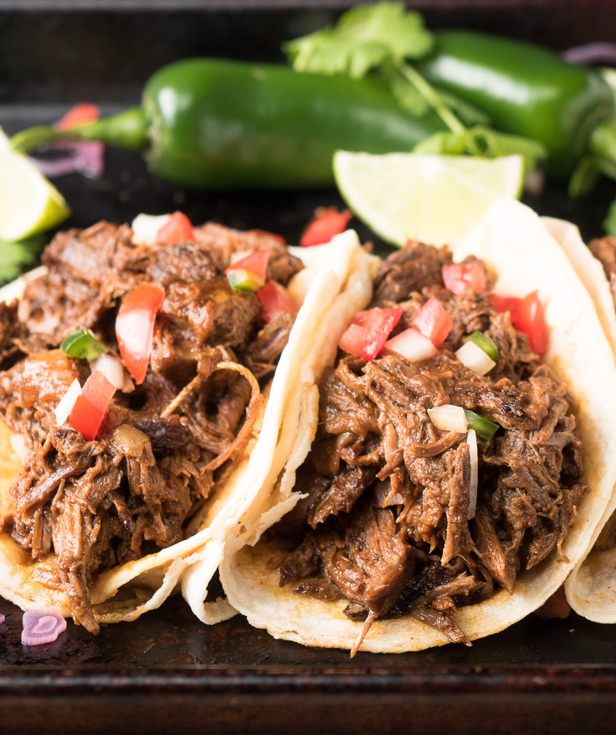Beef barbacoa tacos up close.