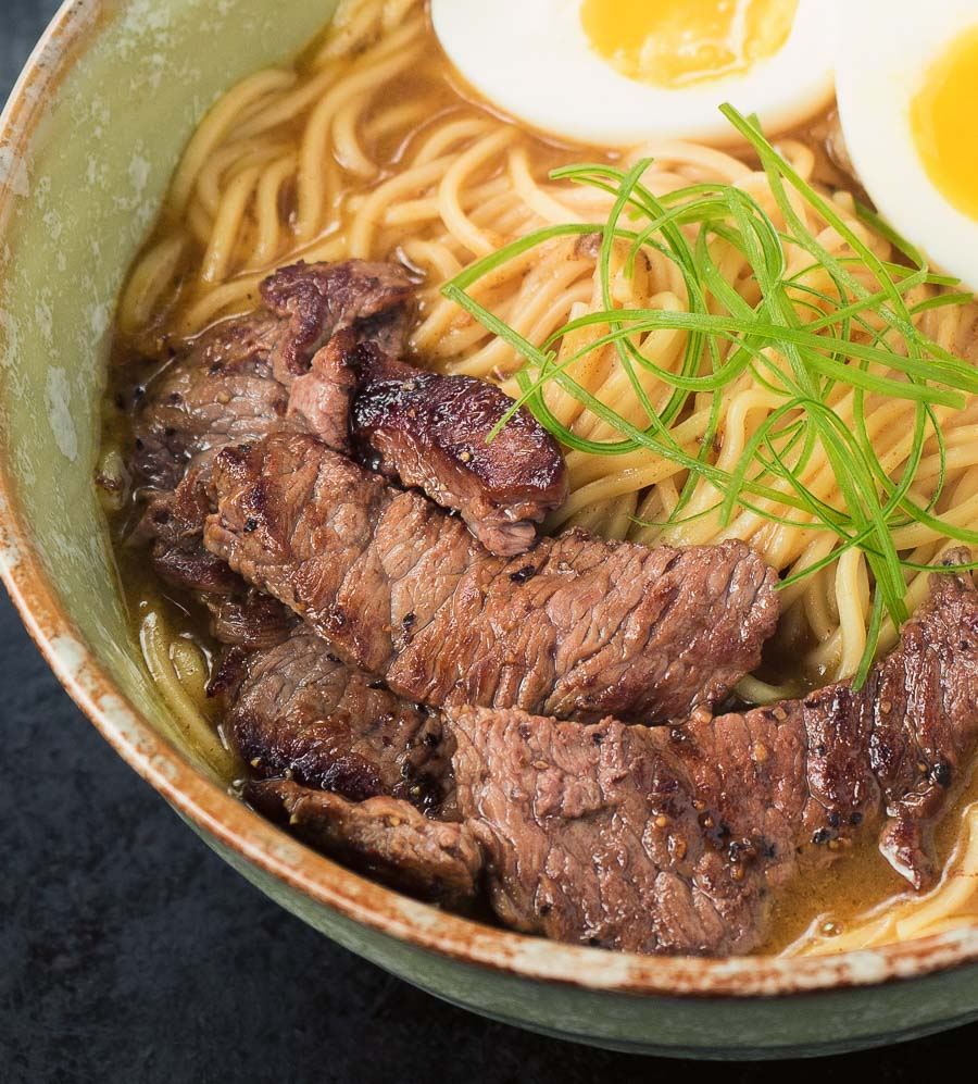 Close up of beef in a bowl of curry ramen.