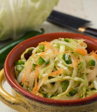 This super easy quick Mexican slaw goes with any type of taco or grilled meat.