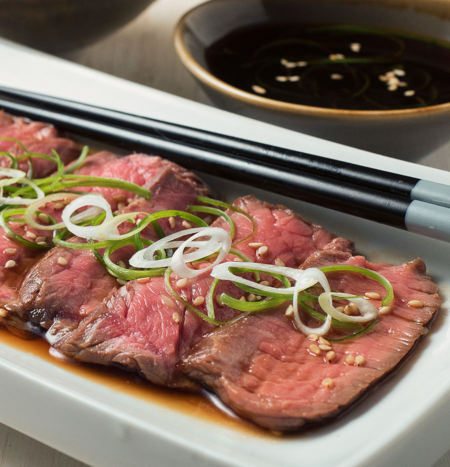 beef tataki on a white plate close-up.