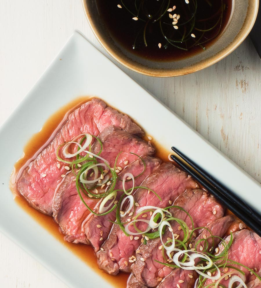 beef tataki in a pool of ponzu sauce.