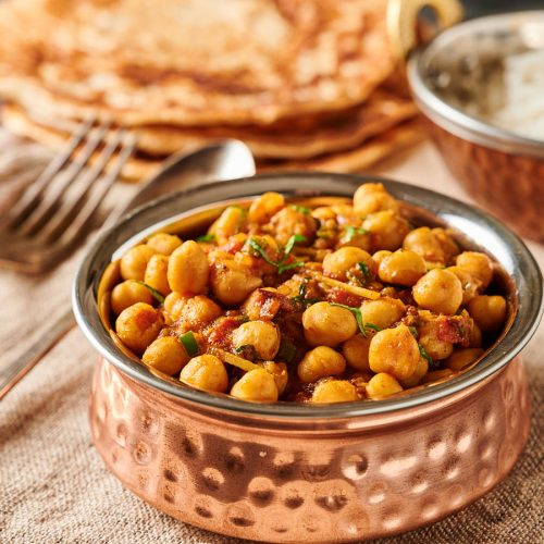 Easy chana masala in an Indian bowl from the front.