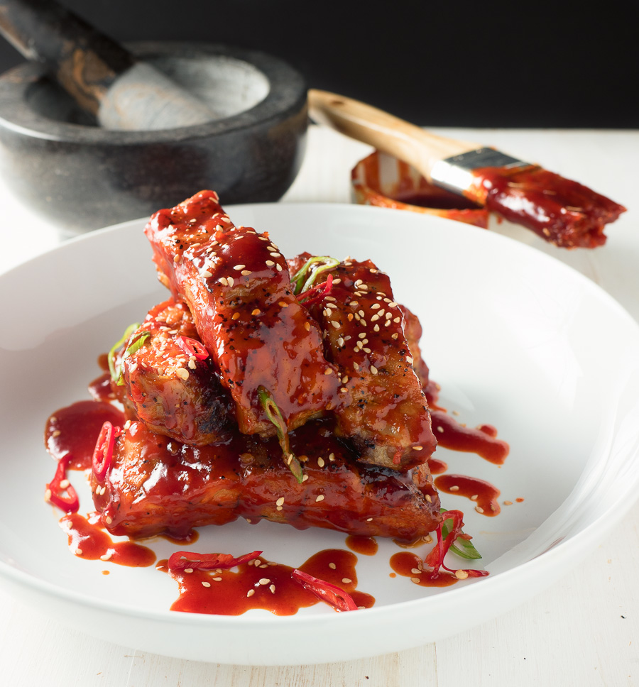 Individual sticky Korean pork ribs with sesame seeds front.