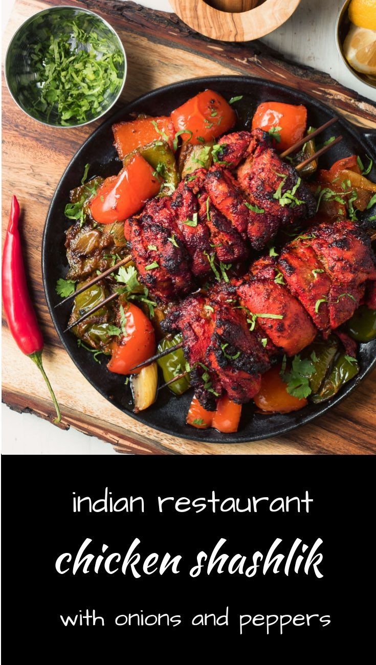 Indian restaurant chicken shashlik. Tandoori chicken with peppers and onions.