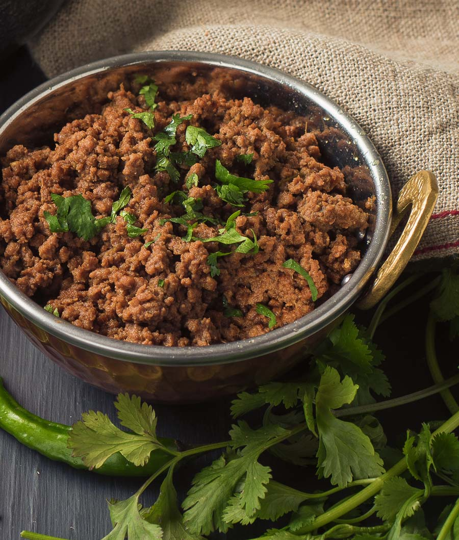Close up of beef keema in an Indian copper bowl.