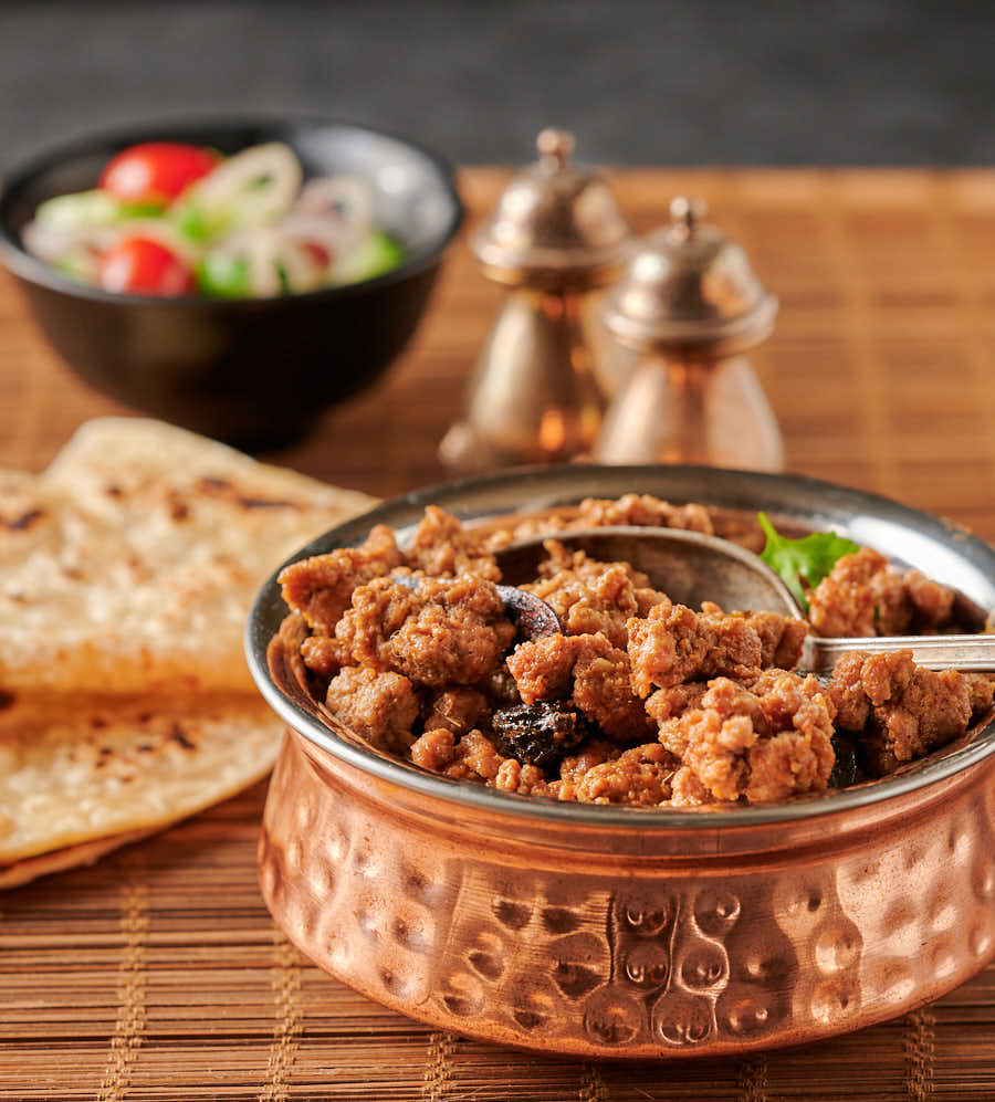Lamb keema in a copper bowl from the front.