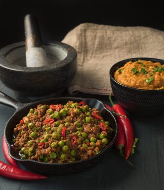 indian restaurant keema matar in a small cast iron skillet