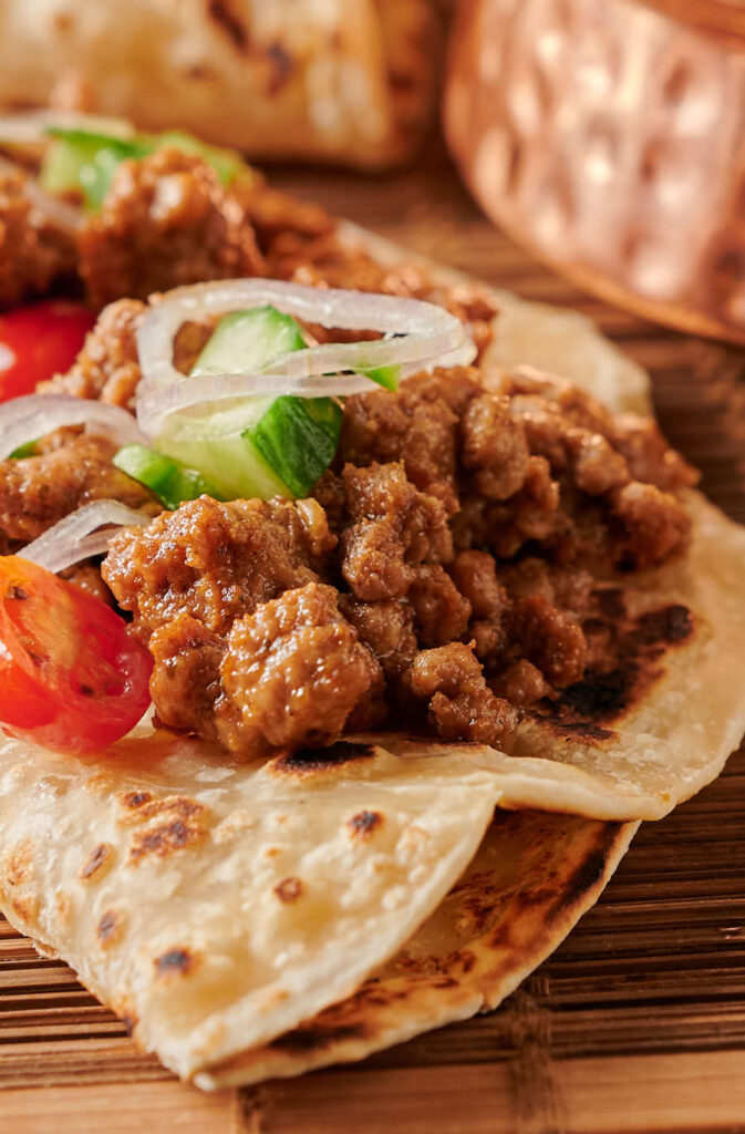 Lamb keema on a paratha - close up from the front.