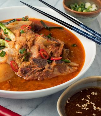 Gamjatang - Korean pork bone soup close up from the front