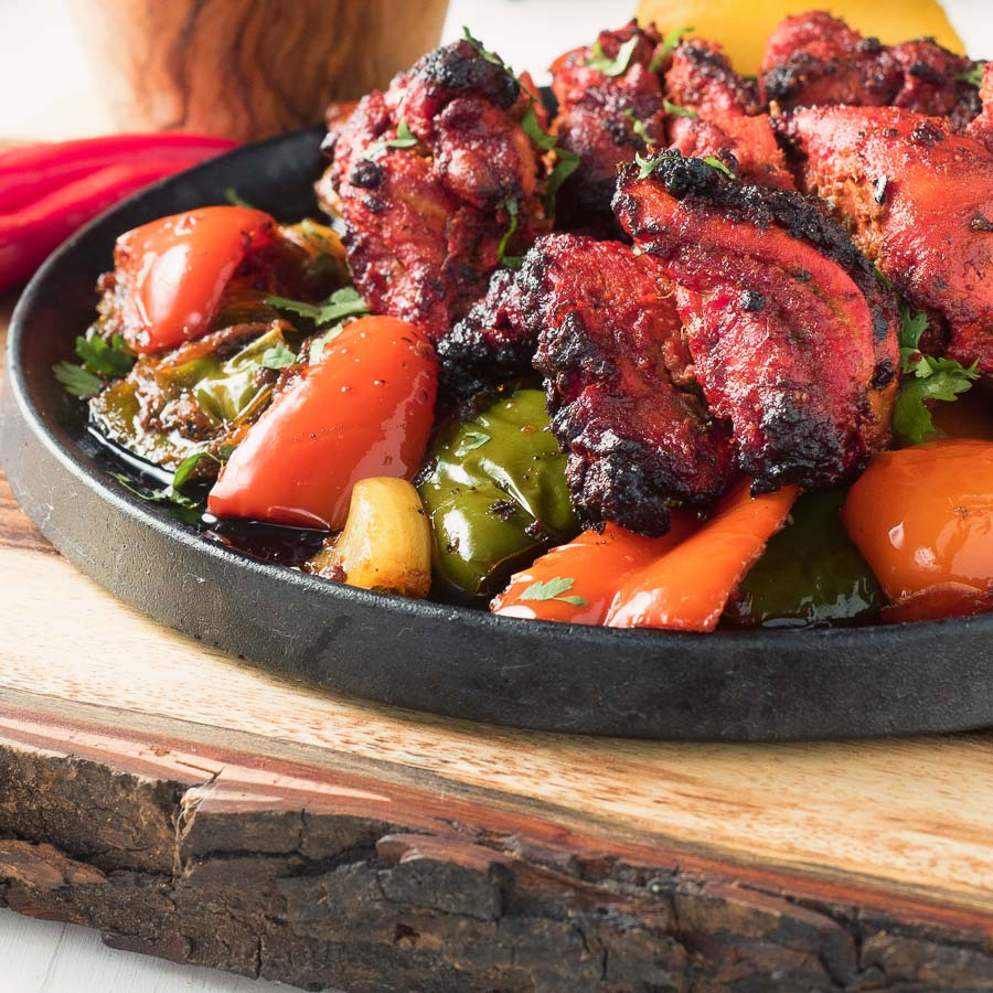 Chicken shashlik - chicken tikka on a bed of spiced peppers and onions.