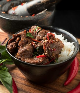 Thai basil beef with red chilies and jasmine rice front view.