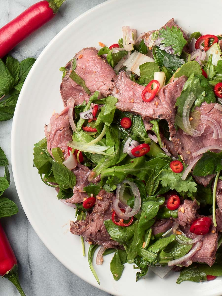 Close up of spicy beef salad from above