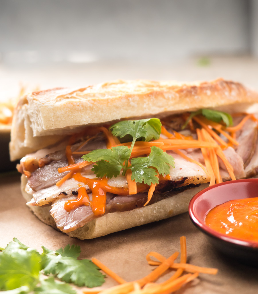 Close-up of pork belly banh mi with Gochujang mayo from the front
