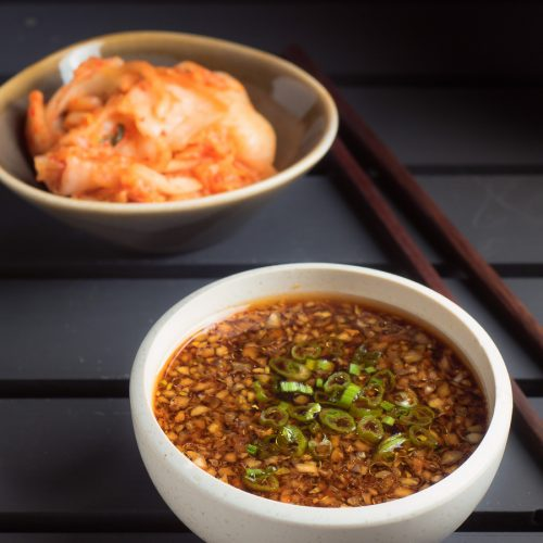 Korean bulgogi sauce in a white bowl on black background.
