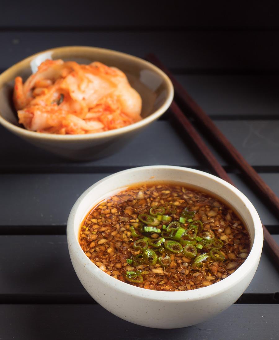 Korean bulgogi sauce in a white bowl on black background.